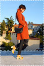 Orange-coat-blue-jeans-yellow-shoes-blue-purse