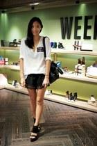 white satin H&M top - black leather balenciaga bag