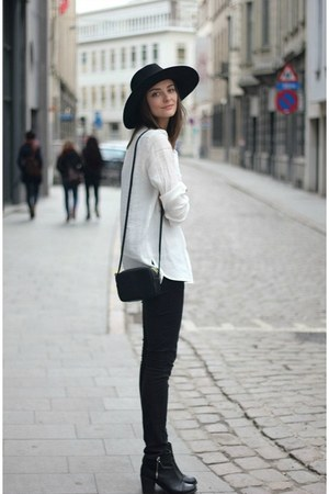 black boots - black jeans - black hat - white shirt - black bag