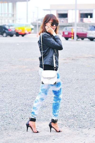black faux leather jacket - blue tie-dyed jeans