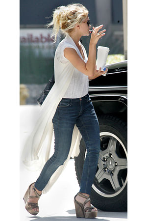 white vest - blue jeans - gold shoes - black purse - black sunglasses - white t-