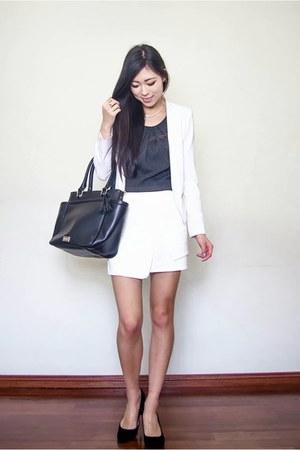 white asymmetrical Spicy Avenue skirt - white crop portmans jacket