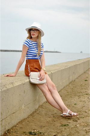 blue Zara shirt - white Target hat - cream coach bag