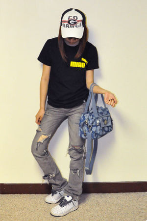 black a Chinese brand t-shirt - gray Levis - white nike shoes - blue Kipling pur