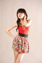 red GOWIGASA top - gold GOWIGASA necklace - orange GOWIGASA skirt