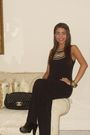 Black-vintage-jumpsuit-from-my-mother-black-chanel-purse-black-mango-clogs-s