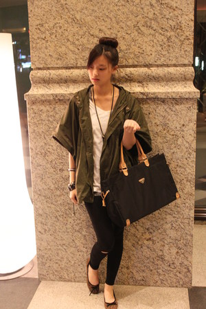 black Prada bag - army green coat