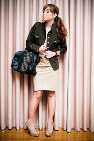 dark green utilitarian Mango jacket - black studded Mango bag