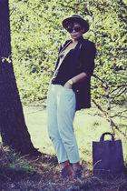 black top - gray pants - brown shoes - blue jacket - beige hat - brown bag