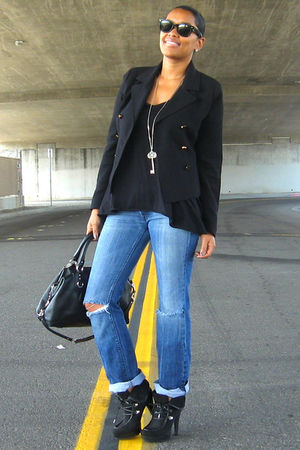 black jacket - black top - blue jeans - black purse - black boots