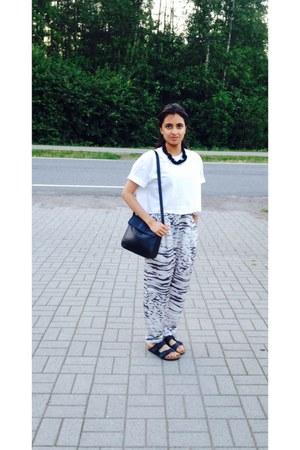 white crop DIY t-shirt - black leather bag - charcoal gray silk Monki pants