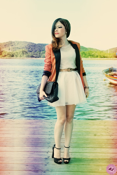 beige skirt - carrot orange blazer - black bag