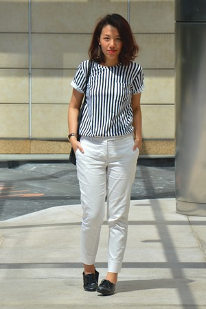white Uniqlo shirt - black Victorias Secret bag - white H&M pants
