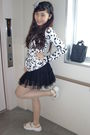 White-jacket-black-skirt-white-shoes-black-accessories-beige-stockings-