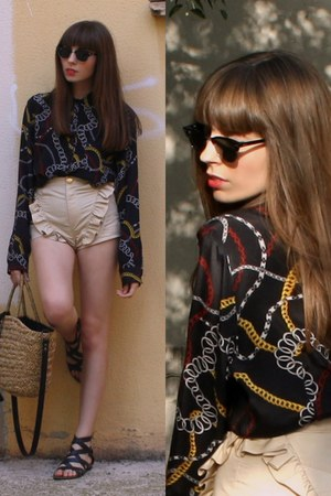 tan unique El Delgado Buil shorts - camel straw H&M bag