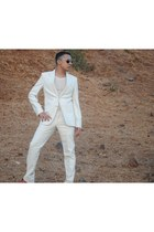 Munir Khamker shoes - cream Munir Khamker blazer - Ray Ban sunglasses