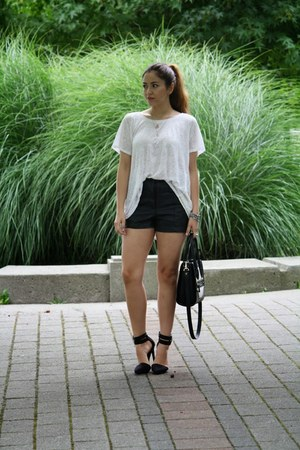 black leather H&M shorts - white Aldo bag