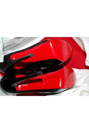 black Christian Louboutin shoes