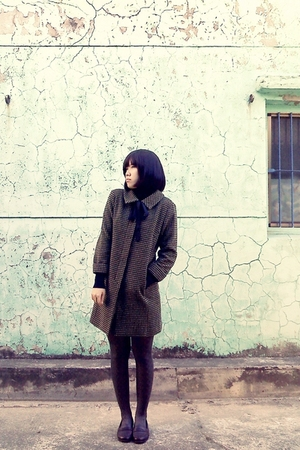 black sweater - green coat - gray tights - brown shoes
