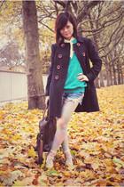 black jacket - blue sweater - blue jeans - beige shoes
