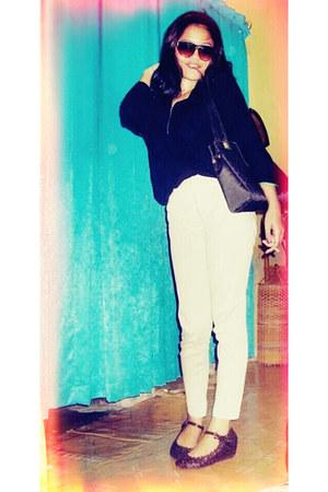 black me in black Chanel bag