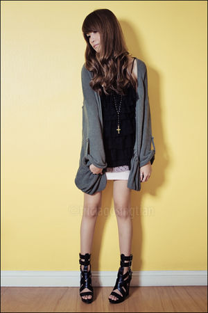 green oversized cardigan - black shoes - black ruffle top - black cross necklace