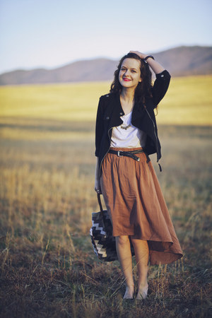 light brown asymmetrical Ruche skirt - black motorcycle Hurley jacket