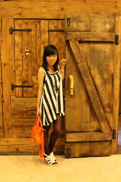 black Gaudi dress - carrot orange balenciaga bag - white Charles & Keith heels