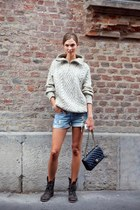 black leather Chanel bag - dark brown boots - off white sweater