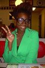 Green-blazer-black-shirt-brown-glasses-white-necklace