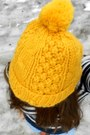Gold-pompom-nike-hat-navy-striped-american-eagle-sweater